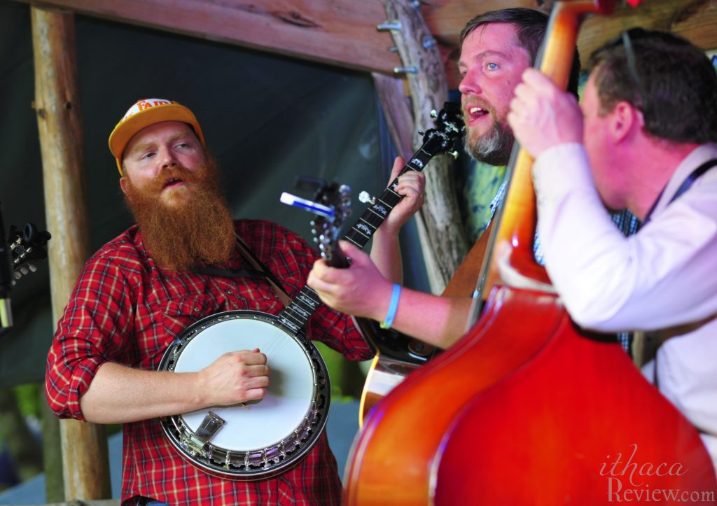 Rylan Broadwell (banjo), Ash Broadwell (guitar), Dion Bor (upright bass) open with their first tune Saturday at Togetherness Fest in Spencer.